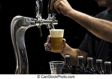 Man drawing beer from tap in an plastic cup. Isolated in a...