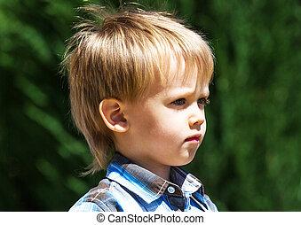 Little scholar - Profile of little boy on green