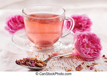 Rose tea, flowers, and dried petals