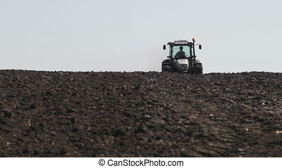 tractor leaves the horizon plowed field - SMELA,...