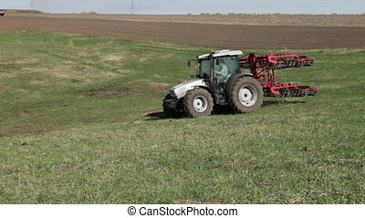 tractor with plow move with plowed field - SMELA,...