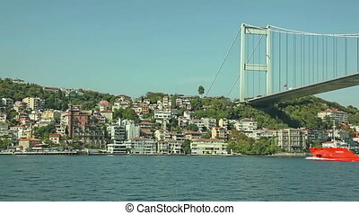 Istanbul Second bridge - Red ship passing under the Fatih...