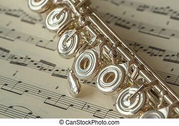 flute on a background of sheet music