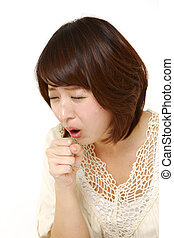 woman coughing - studio shot of young Japanese woman on...