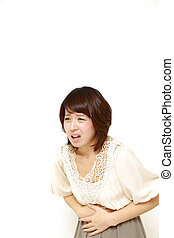 woman suffers from stomachache - studio shot of young...