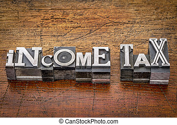 income tax in metal type - income tax - financial concept -...