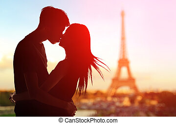 Romantic lovers with eiffel tower - silhouette of romantic...