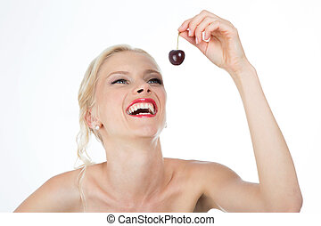 smiley girl with cherry - beautiful woman is happy to eat...