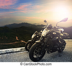 motorcycle parking on top of mountain with sun light on...