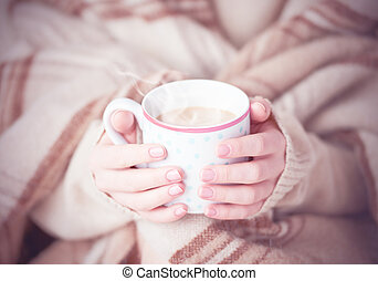 cup of hot coffee warming in the hands o
