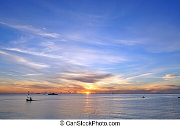 ocean blue sky and sunrise