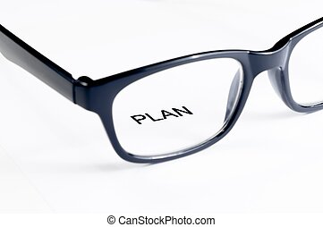 plan word see through glasses lens, business concept - plan...