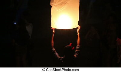 glow Chinese lantern - man with flash horn hold glow Chinese...