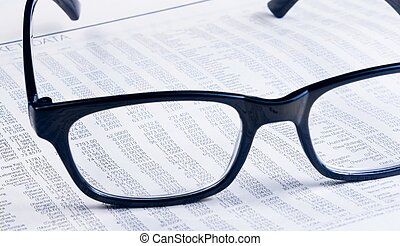 business financial newspaper report see through glasses...