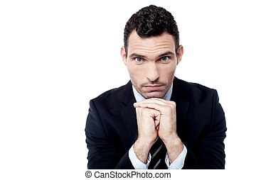 I have a serious plan - Businessman posing to camera while...
