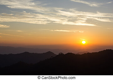 Sunrise and Silhouette Mountain at Thong Pha phum National...