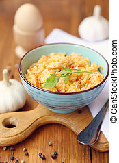 pilau - fresh pilau in a bowl with a garlic, in a studio
