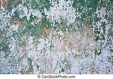 Grunge wall texture background. Paint cracking off dark wall...