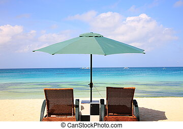 beach resort - Lounge chairs and parasol on the beach