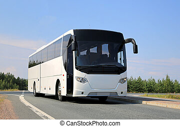 White Bus on the Road - White coach bus on the road at...