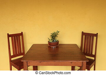 Dining table with yellow wall