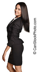 Business woman standing sideways leaning back slightly -...