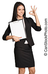 Business woman holding a clip board in hand and the other shows okay.