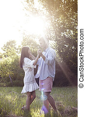 Young couple dancing in the park - Beautiful young couple...