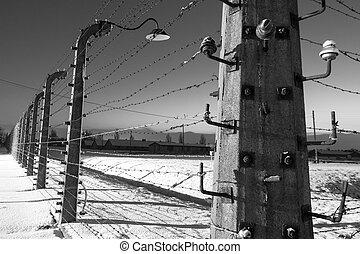 Fence around concentration camp of Auschwitz Birkenau,...