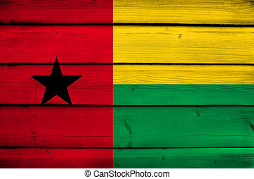 Guinea Bissau Flag on wood background