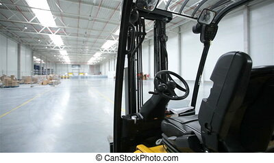 Forklift in a modern storehouse - New forklift in a modern...