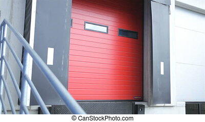 Red ramp for truck in a modern warehouse