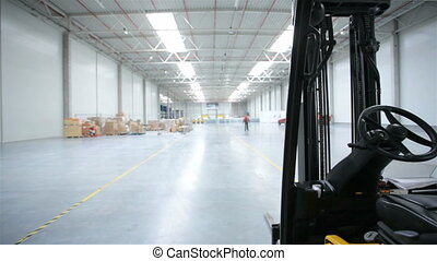 Forklift in a modern storehouse - Forklift and rack in a...