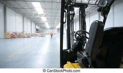 Forklift and rack in a modern storehouse