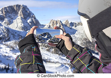 Photographing winter landscape with smart phone -...