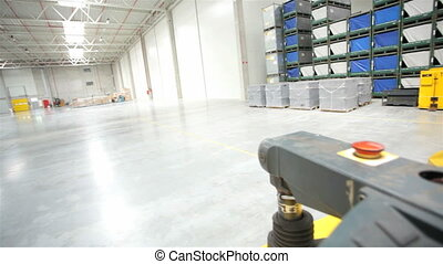 Transporter in a modern storehouse - Yellow forklift in a...
