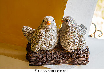 Statues two birds