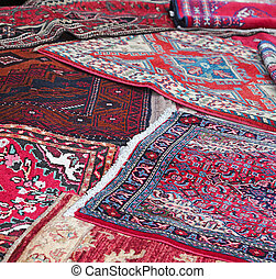 rugs for sale in the shop of fabrics and textiles - many...