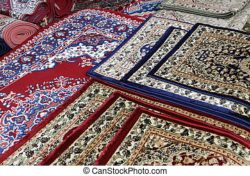 oriental rugs for sale in the shop of rugs - many colourful...