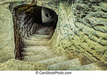 Into The Darkness - Ancient winding stone stairway leads...