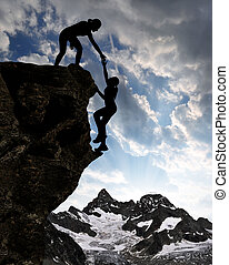 girls climbing on rock - Silhouette of girls climbing on...