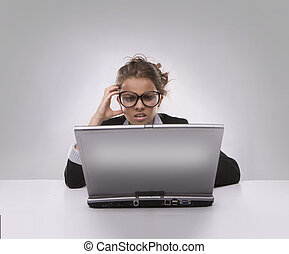 Confused woman using PC - Confused businesswoman using...