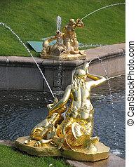 Peterhof - gold sculpture in the park of Peterhof near St...