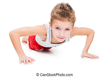 Smiling sport child boy press up exercising - Beauty smiling...