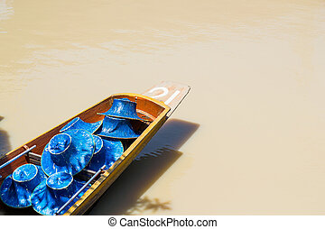 Row boat with hat on the water