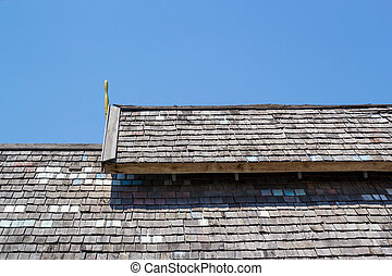 Wood roofing pattern detail on blue sky background