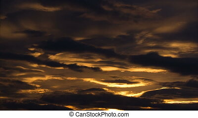 Time lapse of clouds passing gently during sundown with...