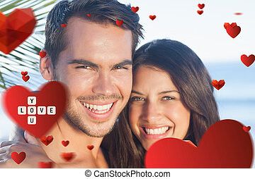 Composite image of cheerful loving couple having holidays -...