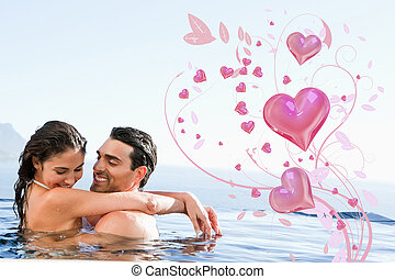 Composite image of couple hugging in the pool - Couple...