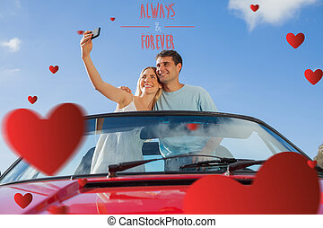 Composite image of cheerful couple standing in red cabriolet...